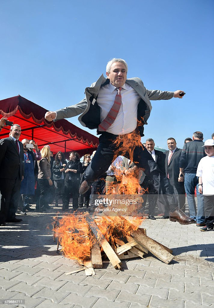 Many student and lecturer celebrate the Nowruz with jumping on the fire as Nowruz is celebrated at the Yildirim Beyazt University Etlik Campus in Ankara,Turkey, on March 21, 2014.