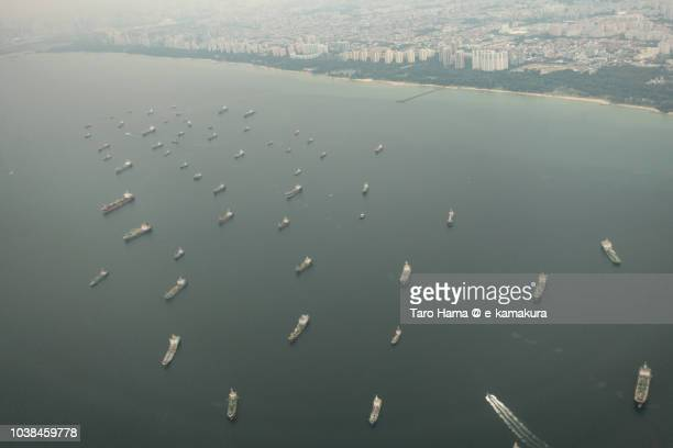 Many tankers on Singapore Strait daytime aerial view from airplane
