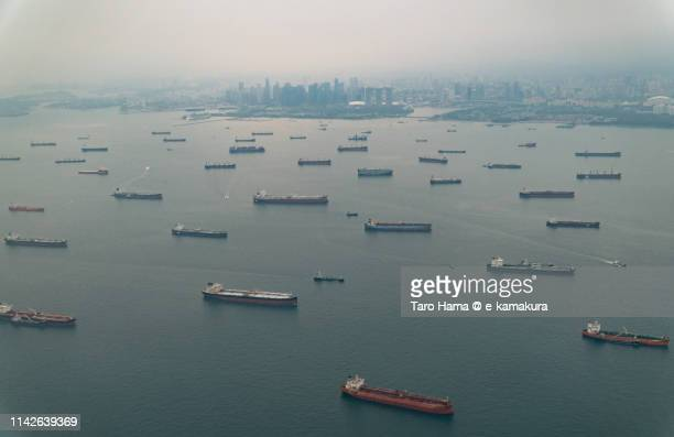 many tankers on singapore strait in singapore, daytime aerial view from airplane - straits stock pictures, royalty-free photos & images