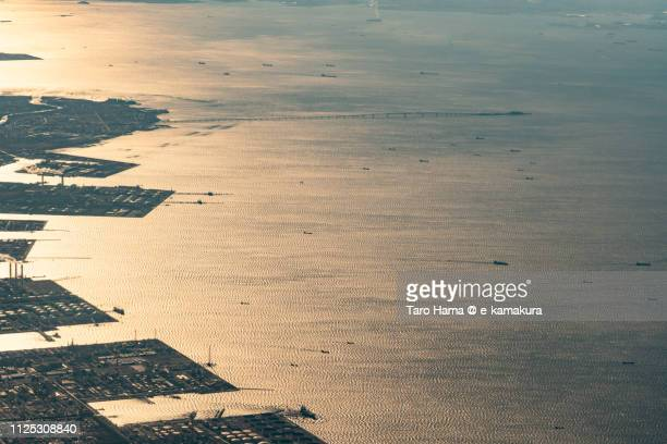 many tankers on tokyo bay and tokyo bay aqua line in japan sunset time aerial view from airplane - 袖ケ浦市 ストックフォトと画像
