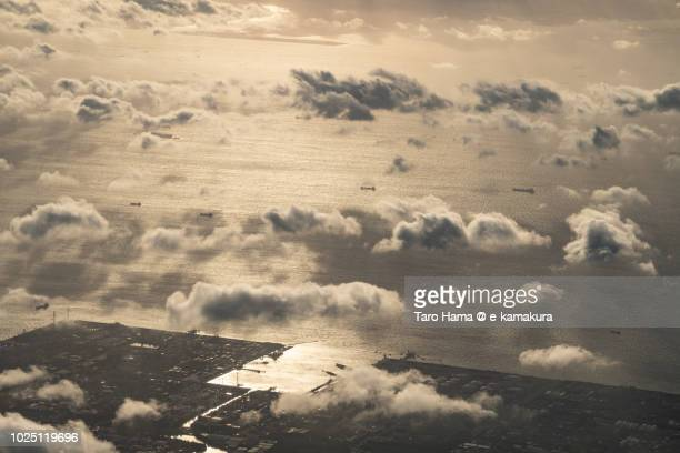 Many tankers sailing on Tokyo Bay, sunset time aerial view from airplane