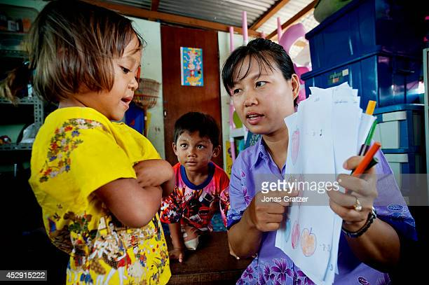 Many Thai volunteers come to help teach young Burmese migrants to read speak and write Thai at a nongovernmental organisation in Phuket Thailand...