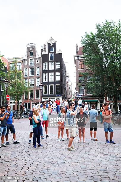Many tourists at canal and gracht Vooburgwal