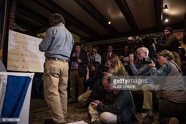 Many US and international journalists observe the counting of ballots just after midnight on November 8 2016 in Dixville Notch New Hampshire the...