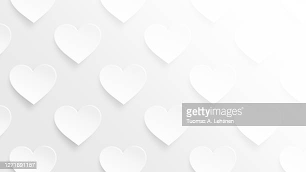many white hearts on a light gray background picture