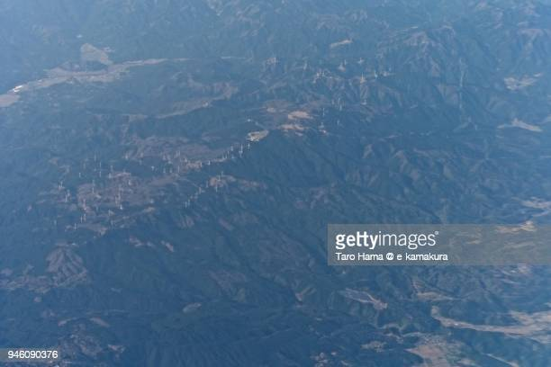 many wind power station on mt. suzuka in mie prefecture in japan daytime aerial view from airplane - mie prefecture stock pictures, royalty-free photos & images