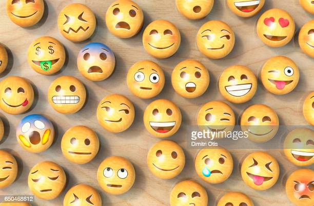 Many wooden emoticon or Emoji face balls from above