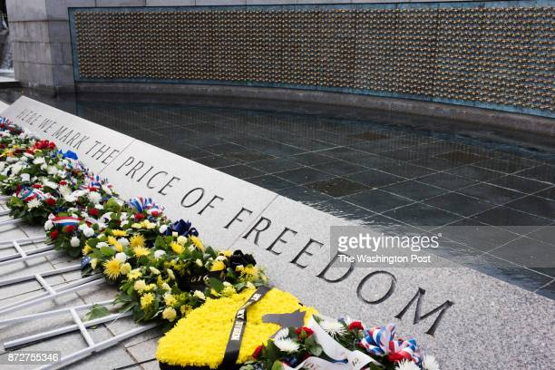 Many wreaths are displayed at the Freedom Wall at the World War Two Memorial as hundreds of people observe Veterans Day on November 2016 in...