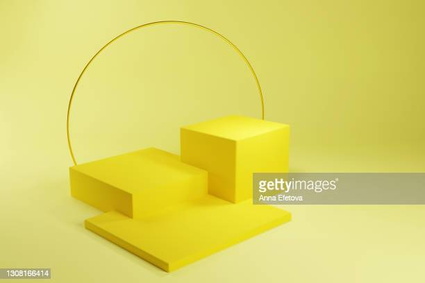 many yellow podiums or stages for cosmetics with accurate golden circle over illuminating background. front view. trendy colors of the year 2021. three dimensional - three objects stock pictures, royalty-free photos & images