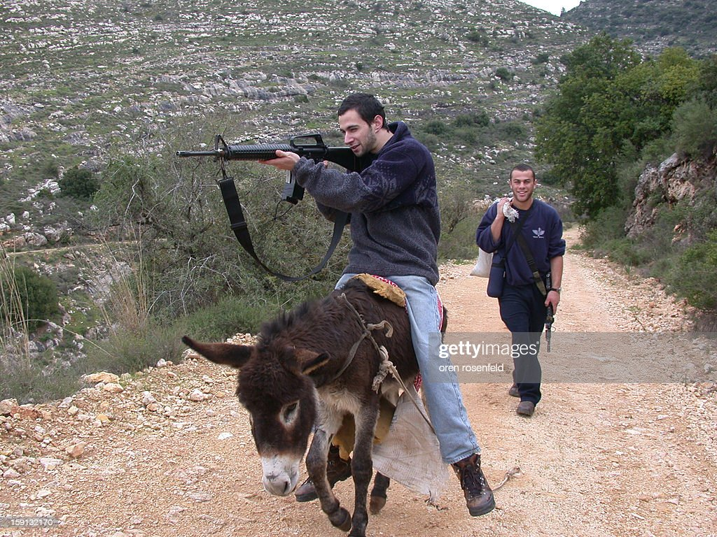 CONTENT] Many young Israelis spend a year after their army service guarding and protecting their community's and get payed a bonus from the government for doing so seen here two of them coming back from a patrol with a confiscated donkey and a sack full of stolen goods the thieves ran away to a Palestinian village a few miles away.