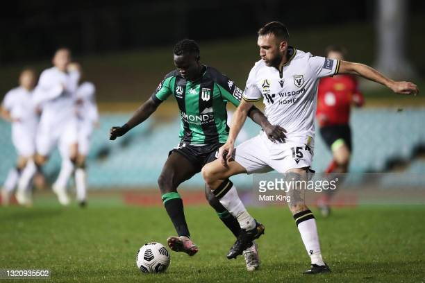 Manyluak Aguek of United is challenged by Aleksandar Susnjar of the Bulls during the A-League match between Western United and Macarthur FC at...
