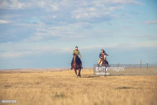 man,Young Couple Riding Horseback On Montana Prairie