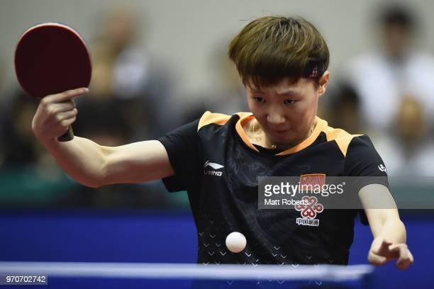 Manyu Wang of China competes against Mima Ito of Japan during the women's singles final on day three of the ITTF World Tour LION Japan Open Ogimura...