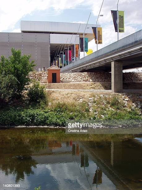 Manzanares River as it passes near the sports complex of tennis The Magic Box, Madrid, Spain.