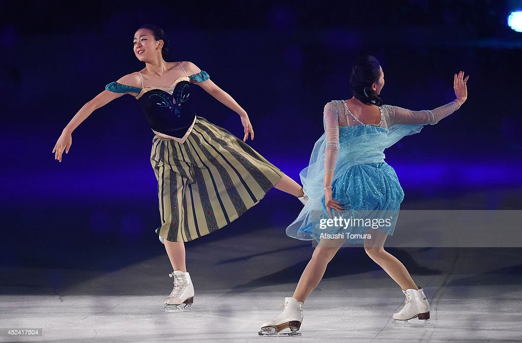 Mao Asada (L) and Mai Asada (R) of Japan perform their routine during THE ICE 2014 at the White Ring on July 19, 2014 in Nagano, Japan.
