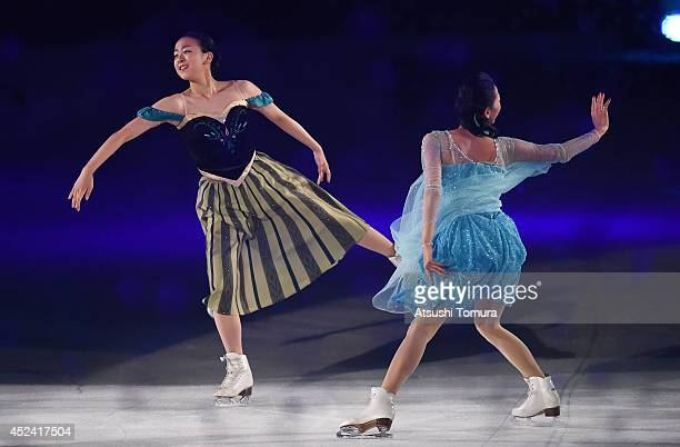 Mao Asada and Mai Asada of Japan perform their routine during THE ICE 2014 at the White Ring on July 19 2014 in Nagano Japan