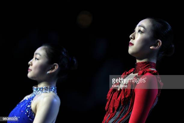 Mao Asada of Japan and Yu-Na Kim of Korea look on from the podium after winning the Ladies Free Skate during the 2010 ISU World Figure Skating...