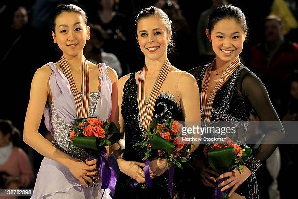 Mao Asada of Japan Ashley Wagner and Caroline Zhang pose for photographers on the victory podium after the Ladies Competition during the ISU Four...
