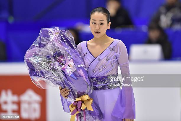 Mao Asada of Japan holds flowers in the Ladies free skating during the day three of the 2015 Japan Figure Skating Championships at the Makomanai Ice...