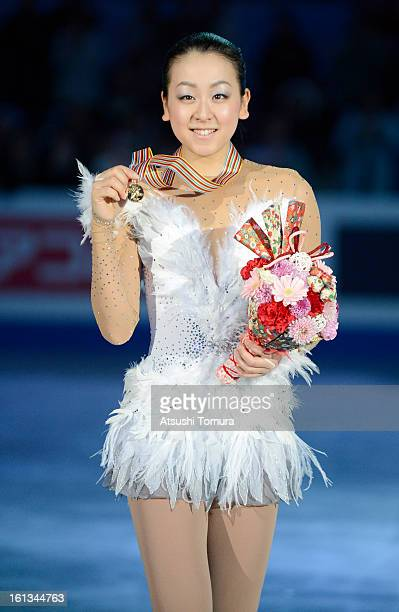 Mao Asada of Japan pose after the medals ceremony during day three of the ISU Four Continents Figure Skating Championships at Osaka Municipal Central...