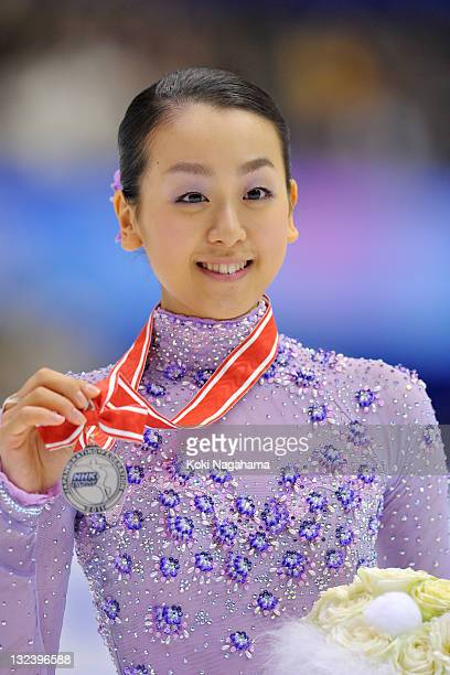 Mao Asada of Japan poses for photograghs in the women's singles during day two of the ISU Grand Prix of Figure Skating NHK Trophy at Makomanai...