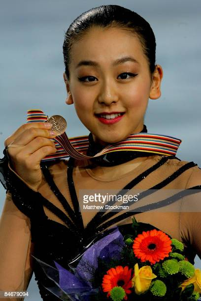 Mao Asada of Japan poses for photographers after the Ladies Free Skate during the ISU Four Continents Figure Skating Championships at Pacific...