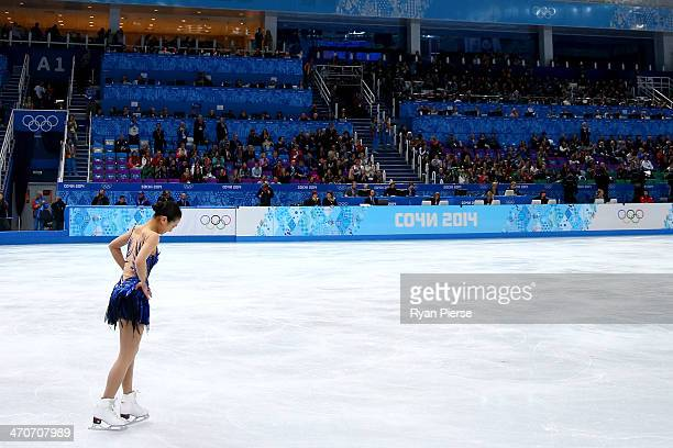 Mao Asada of Japan reacts after competing in the Figure Skating Ladies' Free Skating on day 13 of the Sochi 2014 Winter Olympics at Iceberg Skating...