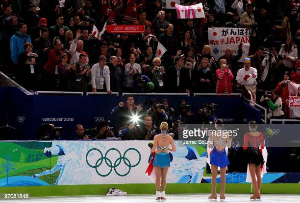 Mao Asada of Japan receives the silver medal, Kim Yu-Na of South Korea receives the gold medal and Joannie Rochette of Canada receives the bronze...