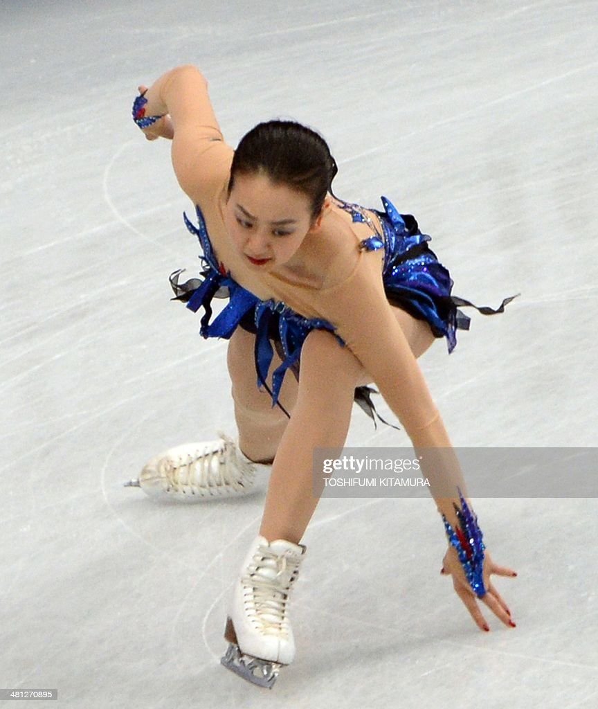 Mao Asada of Japan touches on the ice during her women's singles free skating event at the world figure skating championships in Saitama on March 29, 2014.