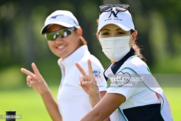 Mao Nozawa of Japan and her caddie and mother pose for photographs during the second round of the Nitori Ladies Golf Tournament at the Otaru Country...