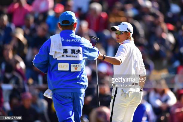 Mao Nozawa of Japan celebrates with her caddie on the 16th green during the third round of the Daio Paper Elleair Ladies at Elleair Golf Club...