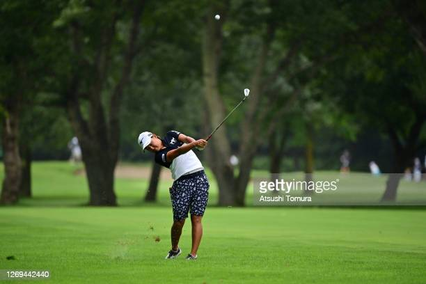 Mao Nozawa of Japan hits her second shot on the 5th hole during the third round of the Nitori Ladies Golf Tournament at the Otaru Country Club on...