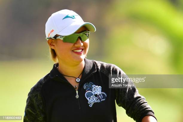 Mao Nozawa of Japan smiles after the eagle on the 15th green during the third round of the Nobuta Group Masters GC Ladies at Masters Golf Club on...