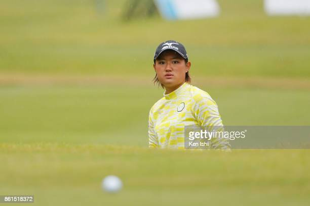 Mao Nozawa of Japan watches on the 17th hole during the final round of the Udonken Ladies at the Mannou Hills Country Club on October 15 2017 in...