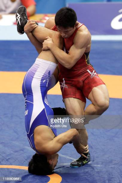 Mao Okui competes against Yuto Miwa in the Men's Freestyle 74kg quarterfinal match on day two of the All Japan Wrestling Invitational Championships...