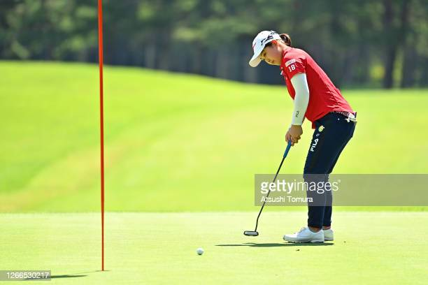 Mao Saigo of Japan attempts a putt on the 4th green during the final round of the NEC Karuizawa 72 Golf Tournament at the Karuizawa 72 Golf Kita...