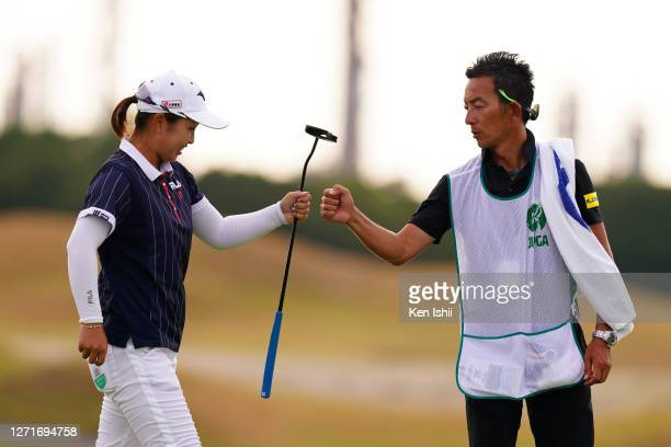 Mao Saigo of Japan elbow bumps with her caddie after holing out on the 9th green during the first round of the JLPGA Championship Konica Minolta Cup...