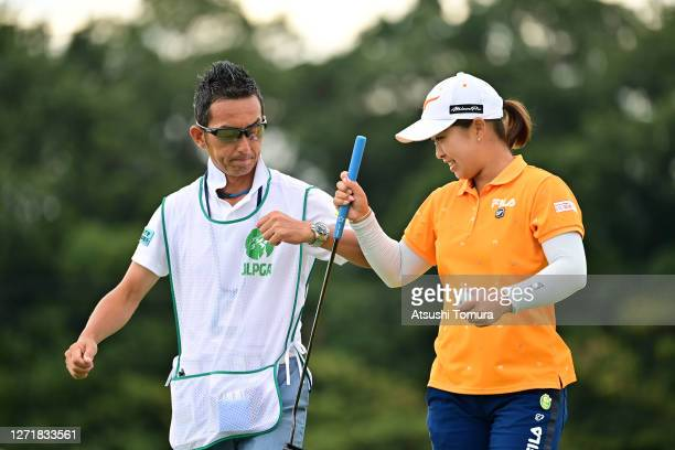 Mao Saigo of Japan elbow bumps with her caddie after the birdie on the 2nd green during the second round of the JLPGA Championship Konica Minolta Cup...