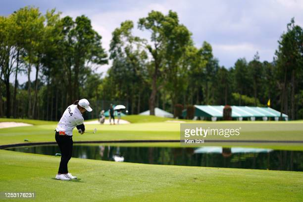 Mao Saigo of Japan hits her third shot after hitting into the water hazard on the 9th hole during the final round of the Earth Mondamin Cup at the...