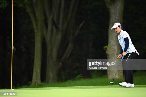 Mao Saigo of Japan holes the birdie putt on the 14th green during the final round of the Earth Mondamin Cup at the Camellia Hills Country Club on...