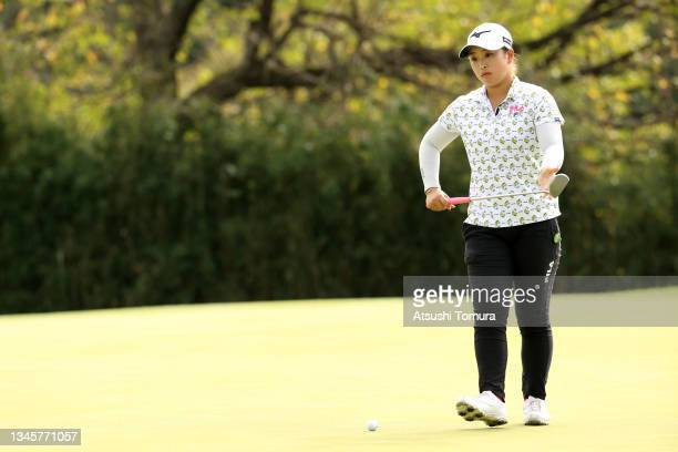 Mao Saigo of Japan lines up a putt on the 13th green during the final round of the Stanley Ladies at Tomei Country Club on October 10, 2021 in...
