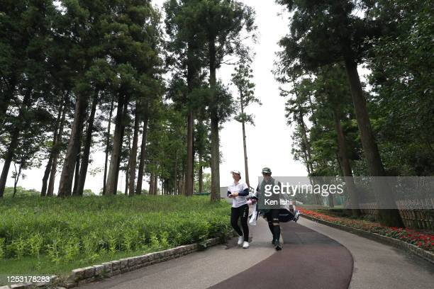 Mao Saigo of Japan walks after the 9th hole during the final round of the Earth Mondamin Cup at the Camellia Hills Country Club on June 29 2020 in...