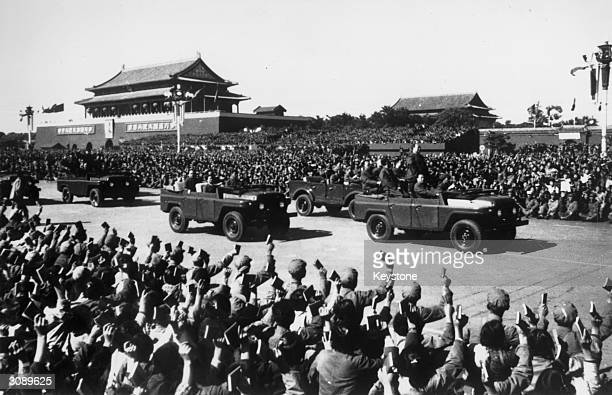 Mao Tse-Tung at a Red Guard rally in Peking. His followers wave their 'Little Red Books' at him as he passes.