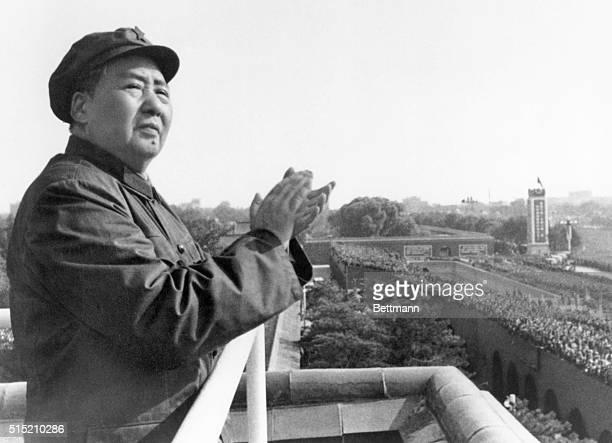 Mao Tse-Tung on a balcony clapping his hands. Undated photograph.