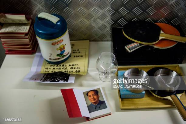 Mao Zedong's Little Red Book sits on a table back stage during a rehearsal of a Cantonese opera called Trump on Show in Hong Kong on April 11 2019 In...