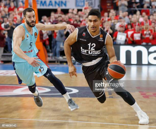 Maodo Lo #12 of Brose Bamberg competes with Pau Ribas #5 of FC Barcelona Lassa in action during the 2017/2018 Turkish Airlines EuroLeague Regular...