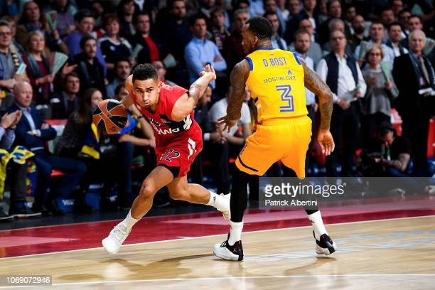 Maodo Lo #12 of FC Bayern Munich competes with Dee Bost #3 of Khimki Moscow Region during the 2018/2019 Turkish Airlines EuroLeague Regular Season...