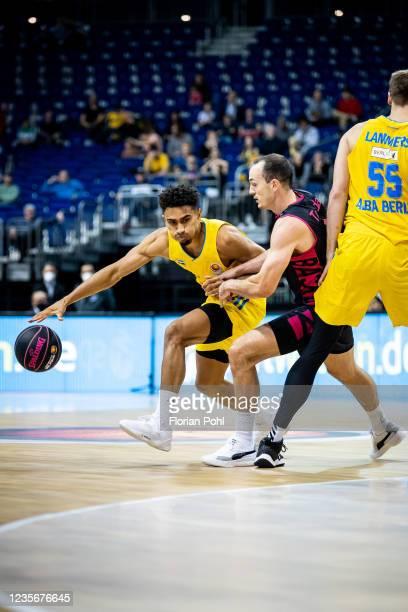 Maodo Lo of Alba Berlin and Karsten Tadda of Telekom Baskets Bonn during the BBL Cup match between ALBA Berlin against Telekom Baskets Bonn at...