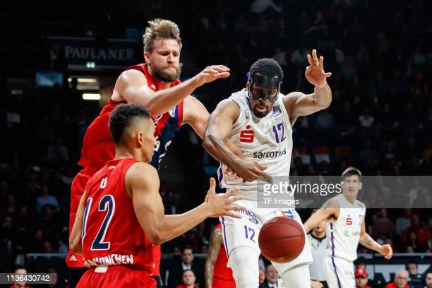 Maodo Lo of FC Bayern Muenchen Danilo Barthel of FC Bayern Muenchen and Darius Carter of BG Goettingen battle for the ball during the easyCredit BBL...