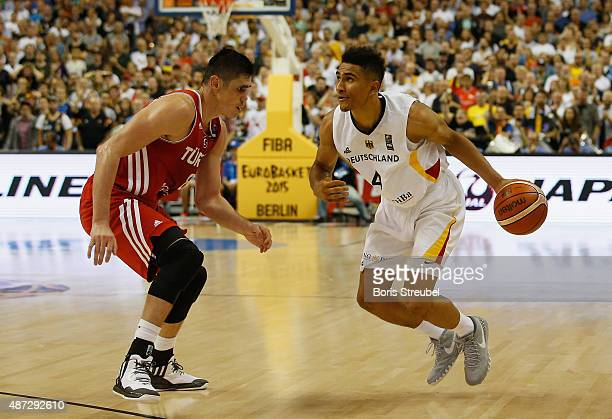Maodo Lo of Germany drives to the basket against Ersan Ilyasova of Turkey during the FIBA EuroBasket 2015 Group B basketball match between Germany...